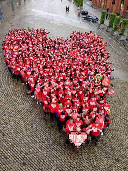 A group of students gathering together to form a giant red love heart for marriage equality as part of the student movement