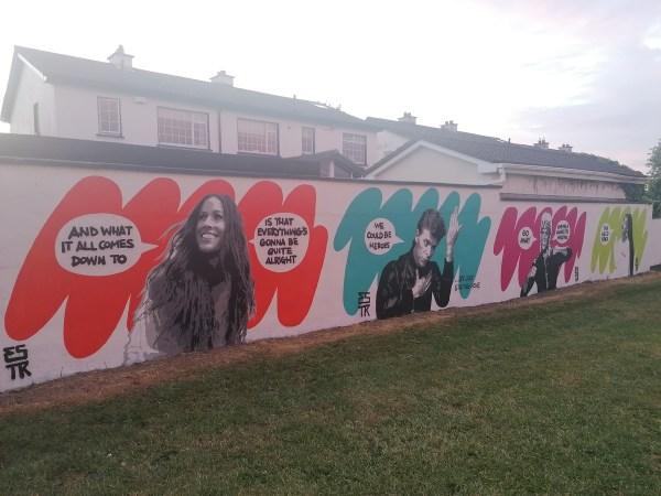 Four street art murals by Emma Blake along her estate wall