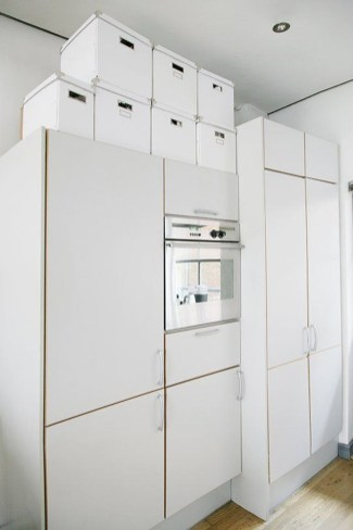 Contemporary Micro Apartment Organized With Boxes 24