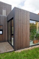 A Wooden House That's Simple On The Outside But Modern On The Inside 21