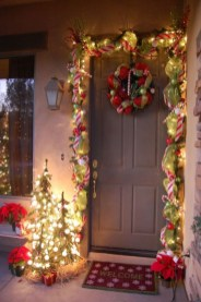Adorable Front Door Christmas Decoration Ideas That Trend This Year 29