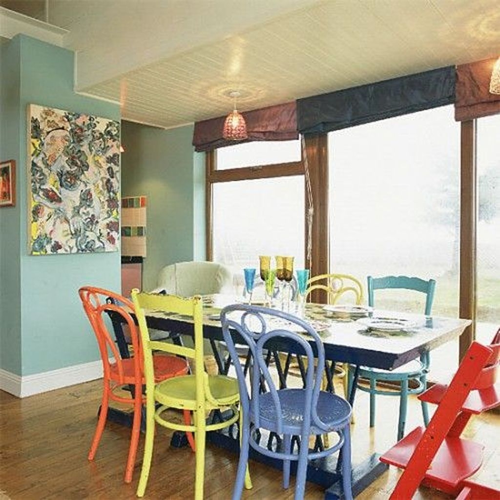 Stunning Dining Room Design Ideas With Multicolored Chairs22