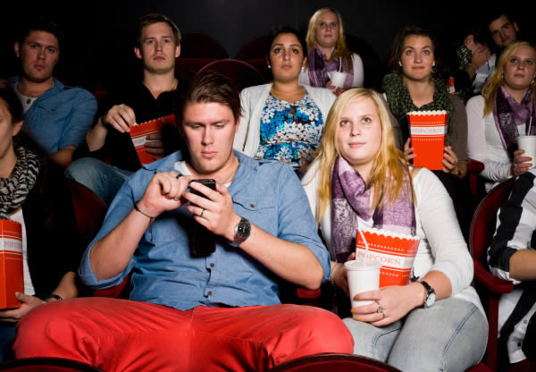 Movie Theater Rewards Texters for Not using their cell phone during a show