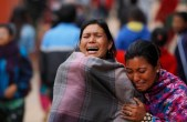 Family members break down during the cremation of an earthquake victim