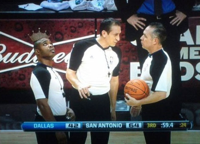 Referee wearing crown during a basketball match