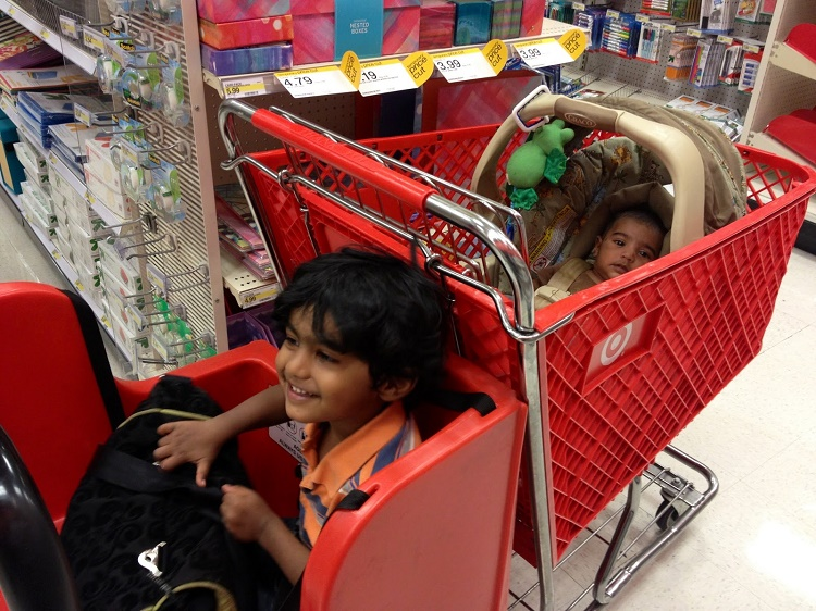Placing kids on a shopping cart while strapped to a car seat
