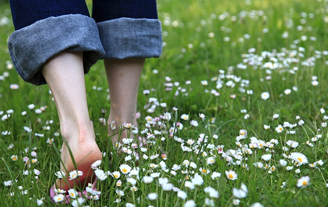 Walk bare foot on dewy grass