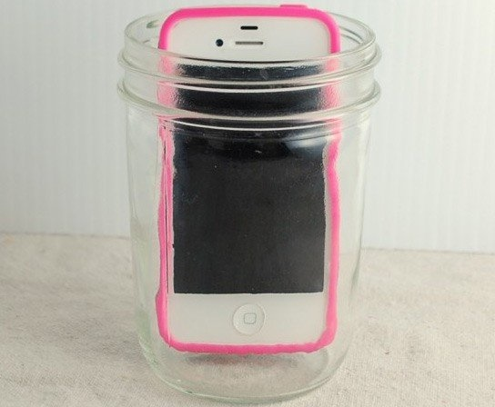 phone in an empty glass cup