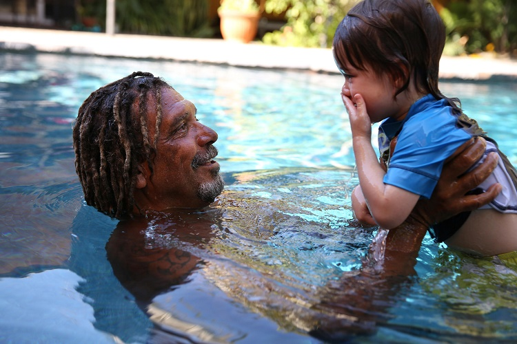 Kid and father in the swimming pool