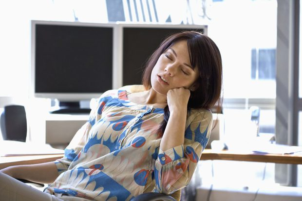 Woman taking a nap in the office