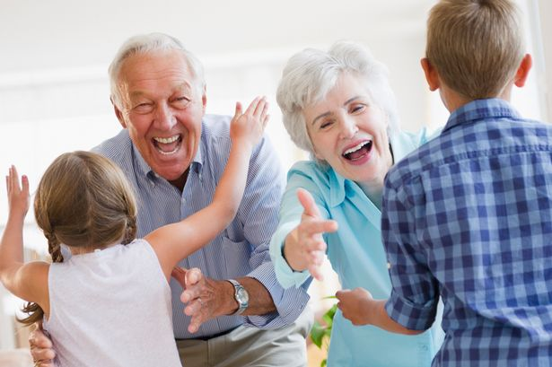 Grandparents playing with kids