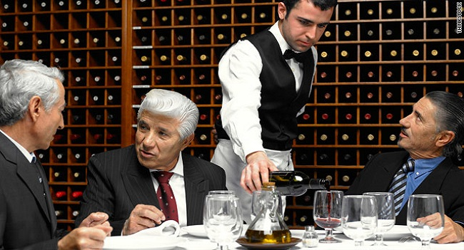 waiter tops up your wine