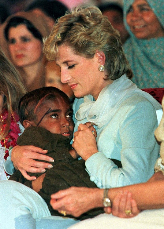Diana holding a child