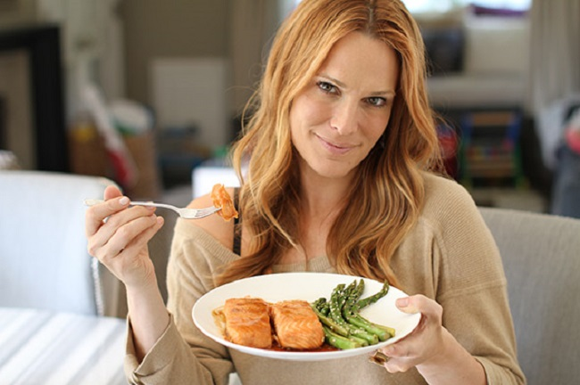 woman eating salmon