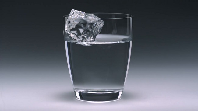 Ice cube in glass filled water