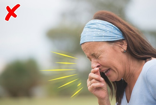 Sneezing without covering your mouth