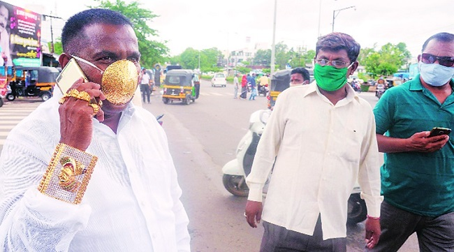 Indian man wearing pure gold mask