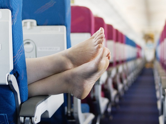 You put your feet on the armrests