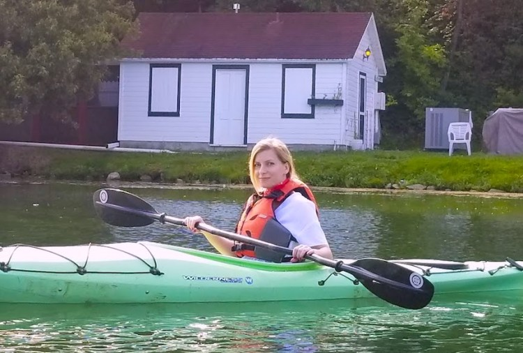 Kayaking is a great summer activity to stay healthy while traveling