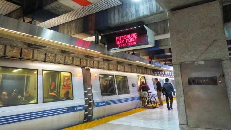 BART train at an underground transportation hub under Market Street