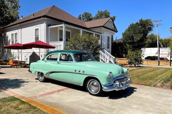 1950s Buick next to Dr. Wikinson's home