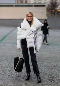 PARIS, FRANCE - JANUARY 24: Camille Charriere wearing a white down feather jacket outside Vetements on January 24, 2017 in Paris, Canada. (Photo by Christian Vierig/Getty Images) *** Local Caption *** Camille Charriere