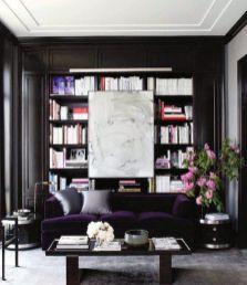 Plum-velvet-sofa-with-bookcase-and-white-art