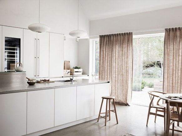 minimalist-Scandinavian-kitchen-open-plan-living-space.-big-windows-with-curtains