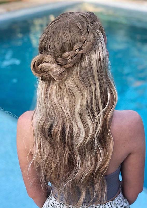 Half up four strand braids with messy bun