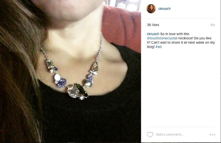 Touchstone necklace on purple dress