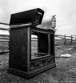Hallowed out television mailbox.