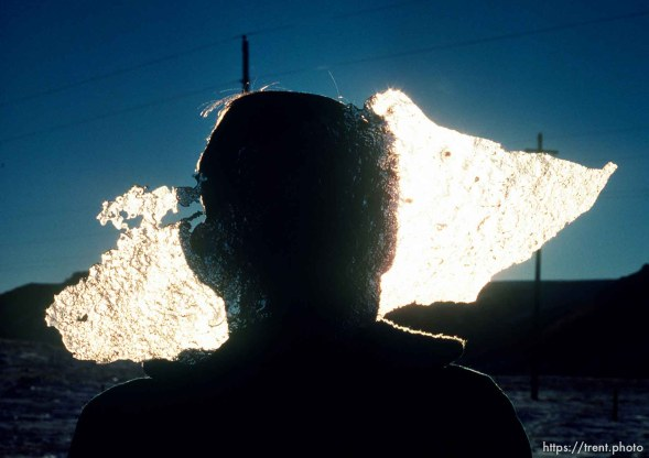 CG holds a piece of ice in front of his face, march 1988.