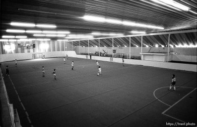 Overhead of action at an indoor soccer tournament.