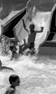 Kids water-sliding at Classic Skating Rink.