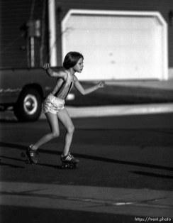 Tessa Clark rollerskating in the street.