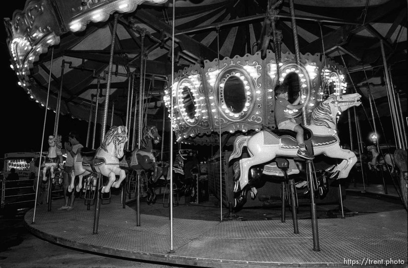 People on the merry-go-round at the carnival.