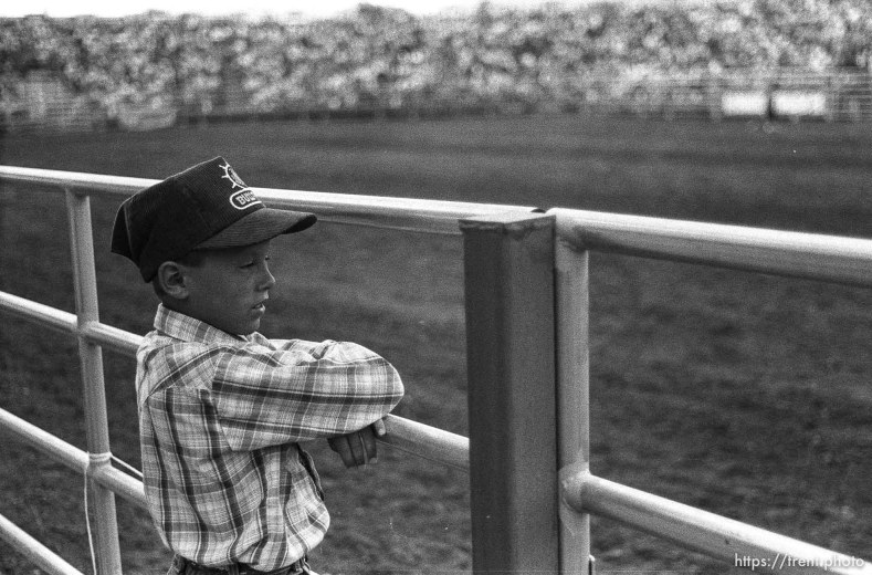 Kid watching the Spanish Fork Fiest Days rodeo.