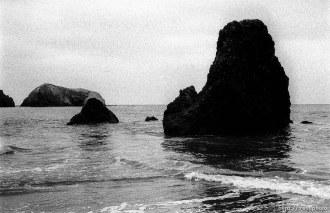 rocks and waves at beach.