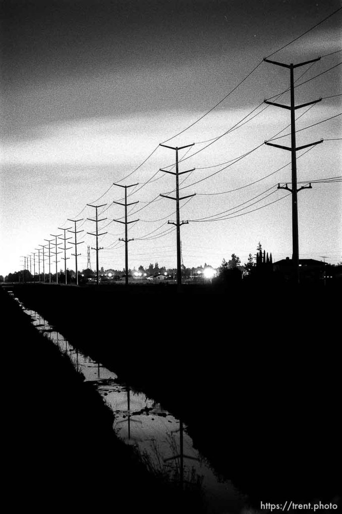 Creek and power lines at night.