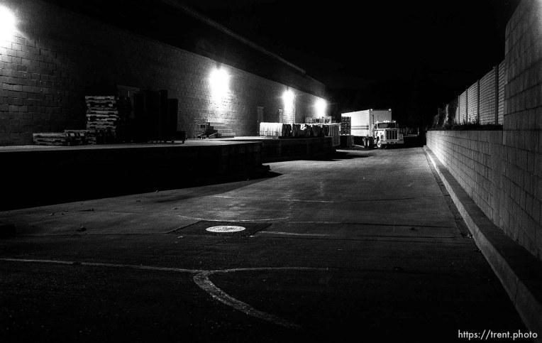 behind Alpha Beta at night.