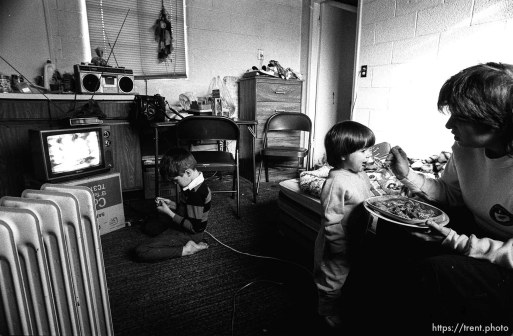 People living in the Hideaway Motel. Girl being fed.