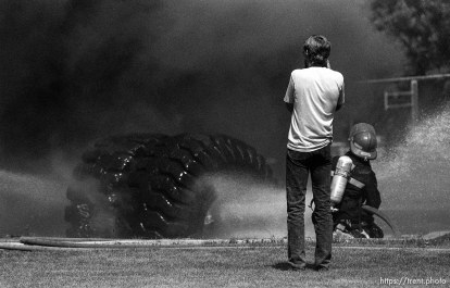 Andrew Holloway photographing a fire in a playground tire.