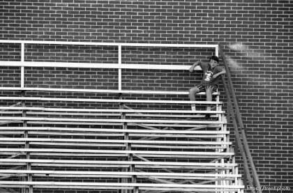 Lone fan, kid in the stands at American Fork football game.