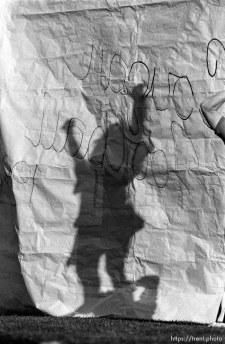 Cheerleader's shadow and banner at BYU vs. Miami football.