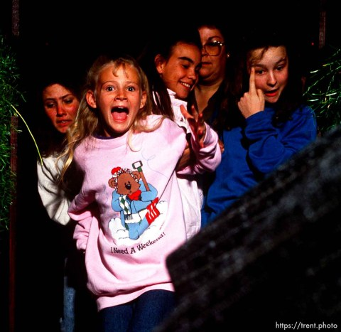 """Girls react to a giant boa constrictor snake in a haunted house, 1990. note the girl's shirt """"I need a weekend!"""""""