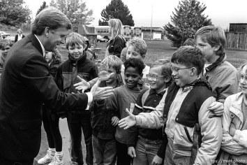 Vice President Dan Quayle shakes hands with schoolchildren.