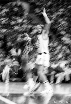 Hakeem Olajuwon runs into Mark Eaton at Jazz vs Houston (slow shutter).