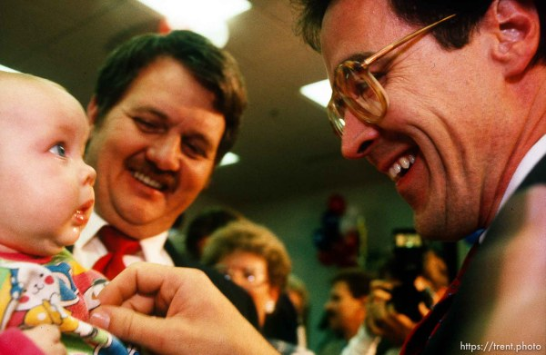 Bill Orton plays with a baby after beating Karl Snow in a Congressional race, 1990. p