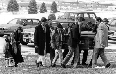 Family carries casket at funeral of School superintendant (Moss).