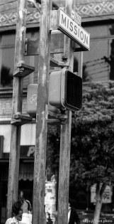 Kid under Mission Street sign